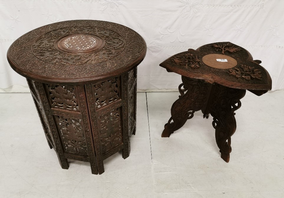Lot 21 - A good small eastern carved hardwood table, the 3 point top embossed with leaf shapes, 40cm h x