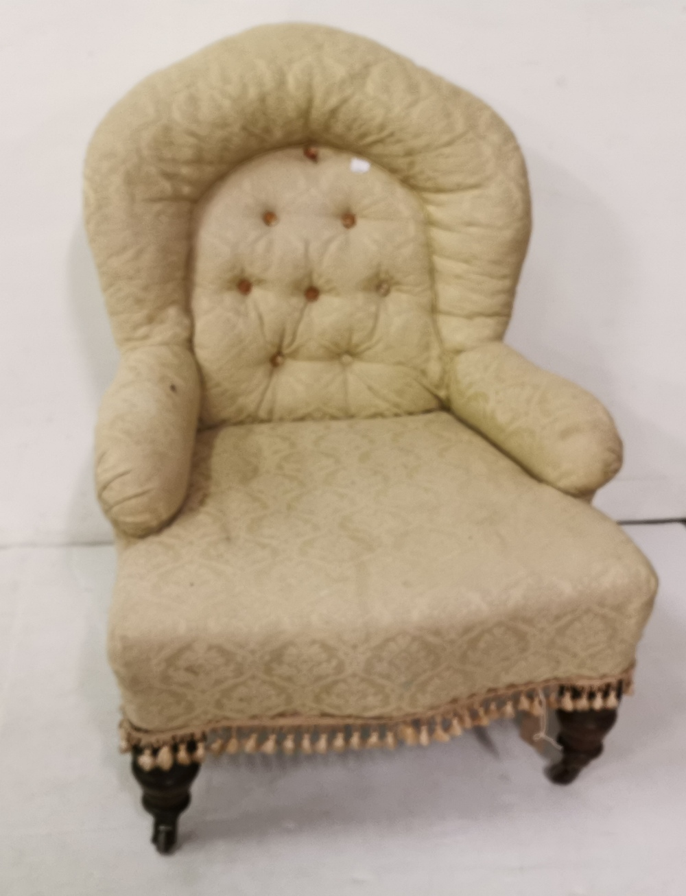 Lot 6 - Low Victorian Easy Armchair, turned legs, beige fabric, button back