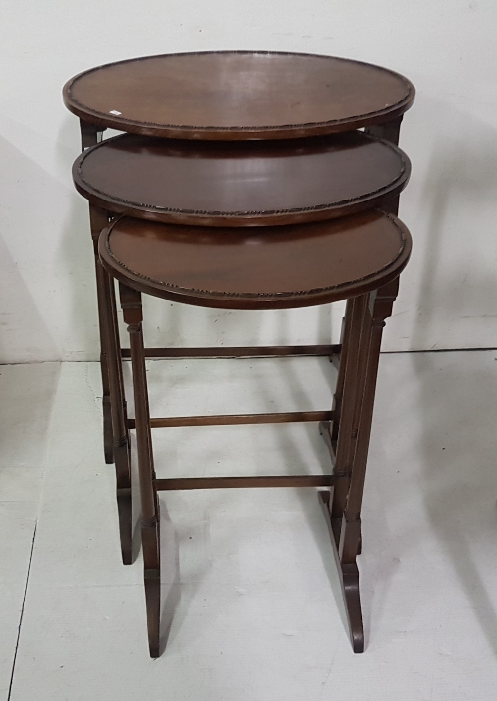 Lot 20 - Nest of 3 oval-shaped Tables, on spindle legs