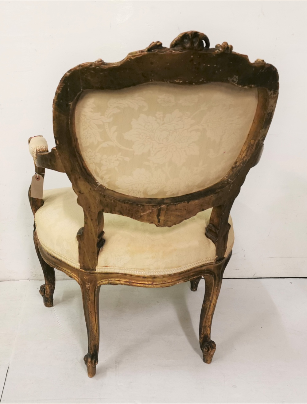 Lot 18 - A French style carved giltwood open Armchair, with cream floral coloured seat and back