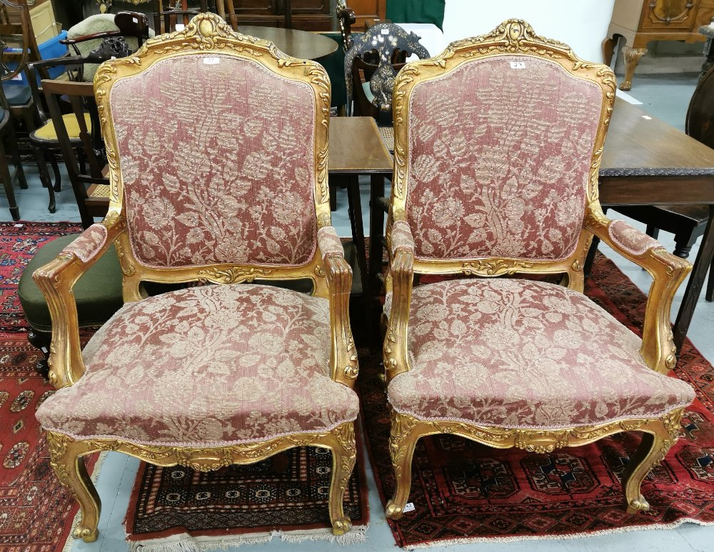 Lot 27 - Matching Pair of carved Gilt Wood Framed Armchairs, the backs and seats covered with red and gold