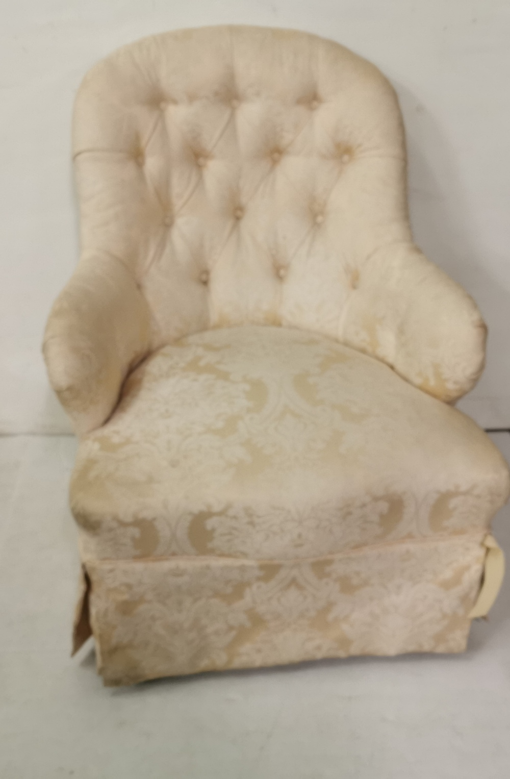 Lot 2 - A Victorian button upholstered Nursing Chair, cream floral fabric, turned legs