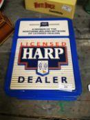 Harp Dealer plastic advertising sign.