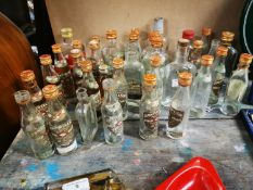 Collection of Baby Power Whiskey bottles