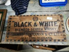 Black and White Scotch Whiskey wooden advertisement.