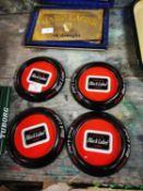 Four tinplate Black Label advertising ashtrays.