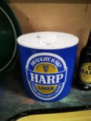 Harp ice bucket and four Harp bottles.