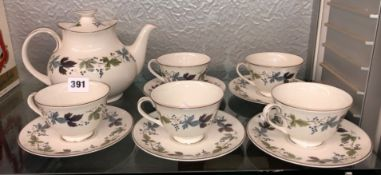 ROYAL DOULTON BURGUNDY PATTERN TEAPOT AND FIVE CUPS AND SAUCERS