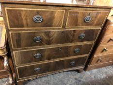 EDWARDIAN MAHOGANY CROSSBANDED AND CHEVRON STRUNG TWO OVER THREE DRAWER CHEST ON BRACKET FEET