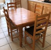 PINE EXTENDING DINING TABLE AND SIX LADDER BACK CHAIRS