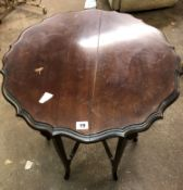 EDWARDIAN MAHOGANY SERPENTINE OCCASIONAL TABLE WITH UNDERTIER