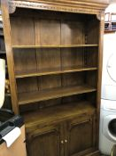 OAK CARVED BOOKCASE CUPBOARD WITH PULL OUT SLIDE