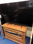 LARGE PANASONIC TV ON HARDWOOD MEDIA STAND WITH REMOTE CONTROL