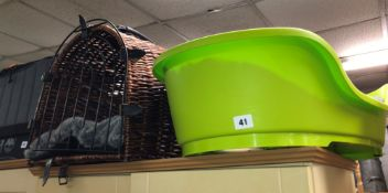 GREEN PLASTIC PET BASKET AND A WICKER HALF MOON CAT CARRY BASKET