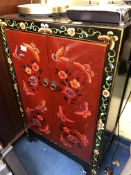 CHINESE INSPIRED BLACK AND PAINTED TWO DOOR CABINET