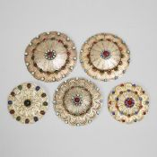 Five Turkmen Jewelled Silver Gilt Gulyakas, early 20th century, largest diameter 5 in — 12.7 cm (5 P