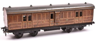 A Carette Gauge One non-corridor bogie guards van. A G.N.R. example in lined teak effect livery,