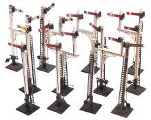 12x O Gauge model railway semaphore signals by Bassett Lowke. Including 3x single arm Home