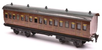 A Marklin Gauge One bogie passenger coach. A G.N.R. example in lined teak effect livery, RN 2875.