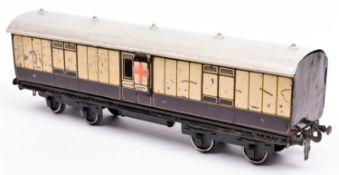 A Gauge One railway Carette LNWR Full Brake bogie van. 1332, in lined chocolate and cream livery