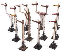 11x O Gauge model railway semaphore signals by Bassett Lowke. Including 5x single arm Home