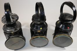 3x Railway Hand Lamps. A 3-aspect BR(E) example with brass plaque for 'Helpston' to one side. An LMS