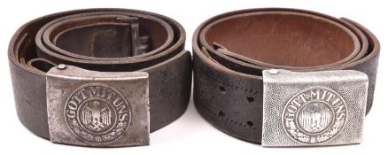 A Third Reich Army aluminium buckle, on its leather belt; and another, of steel, with maker's name