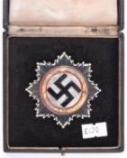 A Third Reich German cross in gold, VGC in case of issue. £475-500