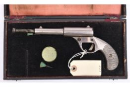 """A pre-1933 .177"""" Dolla pop out air pistol, 9½"""" overall with barrel out, of nickel plated cast iron"""