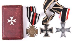 A 1914 Iron Cross 2nd Class; 1914-18 Honour Cross with swords; and grey metal 1939 War Merit Cross