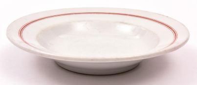 "A Third Reich Kriegsmarine glazed china soup plate, 9½"" diameter, with red lined rim, the base"