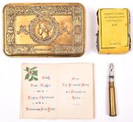A WWI Princess Mary 1914 gift tin, with card, bullet pencil and packet of original tobacco. GC £