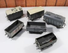 6x O gauge coarse scale freight wagons. 2x Tri-ang plastic wagons; a box van and an open wagon. A