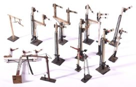 8x O Gauge model railway semaphore signals by Bassett Lowke; 3x single arm Home signals, 2x double