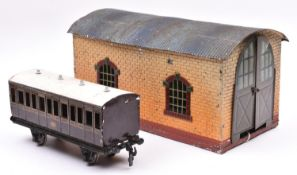 A Bing Gauge One single road engine shed in brick effect, finished in cream and brown with a blue-