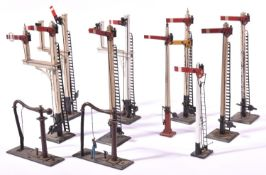 8x O Gauge model railway semaphore signals by Bassett Lowke; 4x single arm Home signals, 3x double