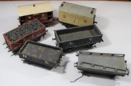 6x O gauge coarse scale kit-built freight wagons. An SR refrigerator box van in white. An NER