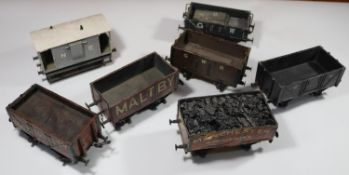 7x O gauge coarse scale kit-built freight wagons. An NER guard's van. 2x GWR open wagons. A GWR