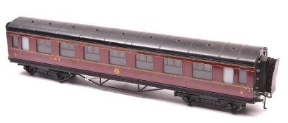 An O gauge LMS corridor coach by Exley. A Full Third, 2211, in lined maroon livery. QGC-GC, some