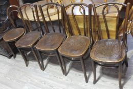 A group of five bentwood cafe style chairs. Condition: each with split to back panel and a couple