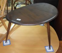 A dark elm Ercol single pebble table, height 40cm, width 66cm. Condition: no signs of any damage,