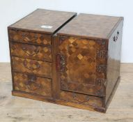 A Japanese parquetry and metal bound miniature cabinet, height 27.5cm, length 36cm, depth 25cm.
