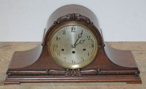 A Junghans steel dial West Minster chime mantle clock in carved oak case, length 53cm, height