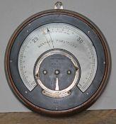A circular oak cased Weather Foreteller by Negretti & Zambra, diam. 26cm.