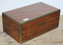 A 19th century walnut writing box with brass inlaid canted corners, tooled black leather writing