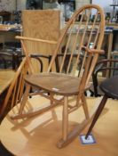 An Ercol blonde elm and beech rocking chair, height 84cm. Condition - good, appears damage/repair