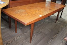 A Gordon Russell teak long coffee table on tapered legs, height 40cm length 121cm. Condition: cup