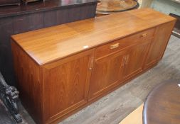 A G-Plan teak sideboard base having central twin handled drawer with cutlery tray over a double door