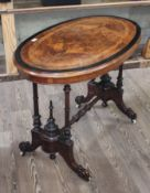 A Victorian walnut cross banded and inlaid oval occasional table with quarter veneered figured top