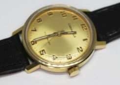 A vintage gold plated Caravelle (Bulova Watch Co.) wristwatch with signed gold tone dial and
